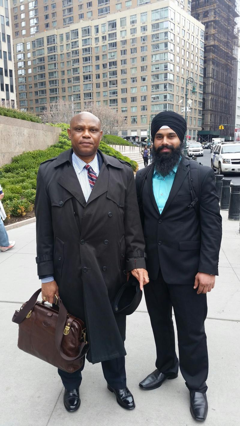 Attorney Jimmy Johnson and His Client Sandeep After Winning His case